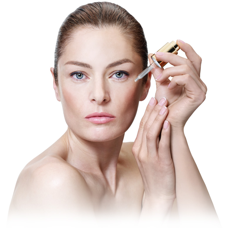 blue eyes woman using liquid cosmetic